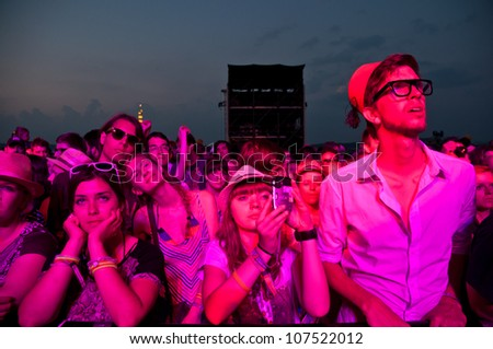 TRENCIN,SLOVAKIA - JULY 7:Visitors of Bazant Pohoda Music Festival at the Trencin Airport in Trencin, Slovakia on July 7, 2012. - stock photo
