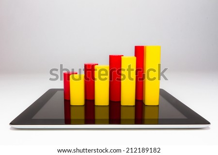 trend chart and computer tablet - stock photo