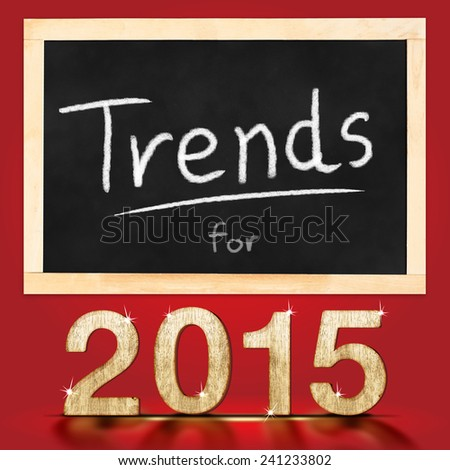 Trends for 2015 on blackboard in red background - stock photo