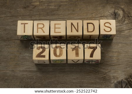 Trends for 2017 text on a wooden background - stock photo