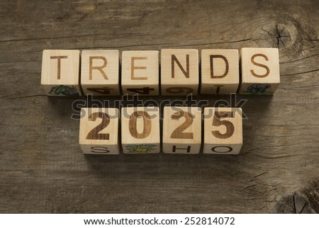 Trends for 2025 text on a wooden background - stock photo