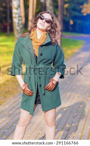 Trendy and Fashionable Caucasian Brunette Female Model with Sunglasses Outdoors.Vertical Image Composition - stock photo