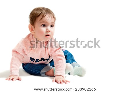 Trendy baby. Child on a white background. Surprised child. Toddler wearing Pants Denim. Picture of a child on white photo. Photo baby isolated. - stock photo