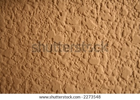 trendy background texture of a stucco wall in a home interior design gallery - stock photo