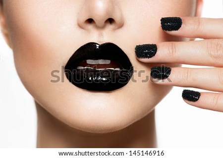 Trendy Black Caviar Manicure and Black Lips. Fashion Makeup and Manicure. Nail Art - stock photo