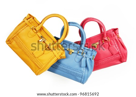 trendy colorful handbags isolated on white