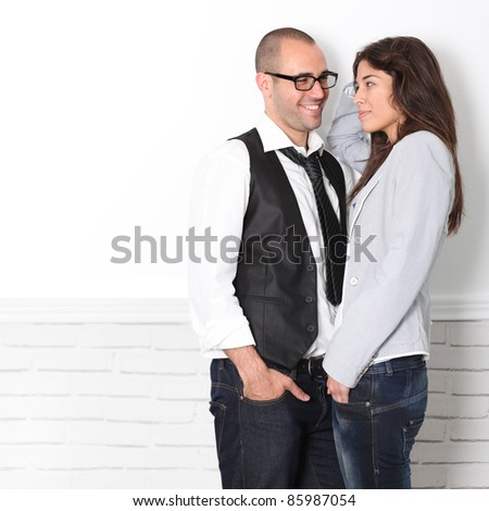 Trendy couple looking at each other's eyes - stock photo