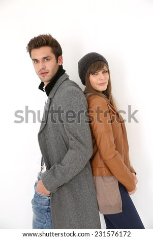 Trendy couple of lovers standing on white background - stock photo