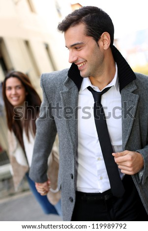 Trendy couple of lovers walking in the street - stock photo