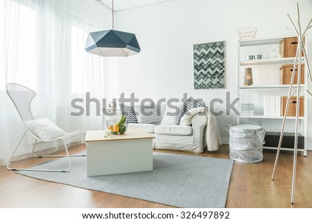 Trendy furniture in small cozy living room - stock photo