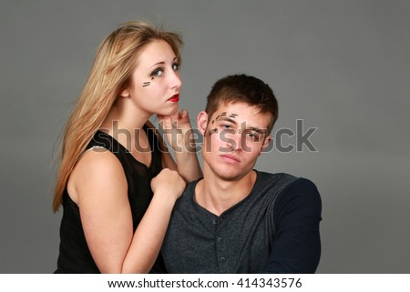 trendy girl and guy fashion models on gray background - stock photo