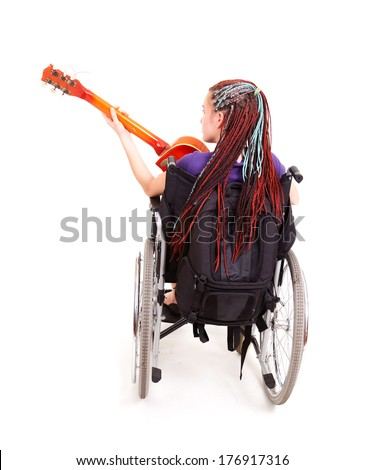 trendy girl with guitar on the wheelchair, white background