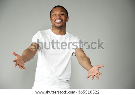 Trendy Happy and Fun Black Male Wearing A White Top - stock photo