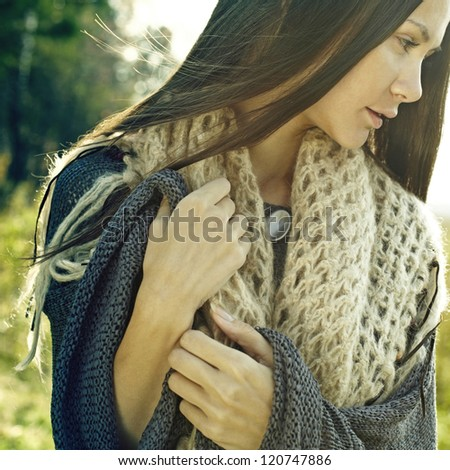 trendy look, a beautiful girl on the nature, fashion spring autumn - stock photo