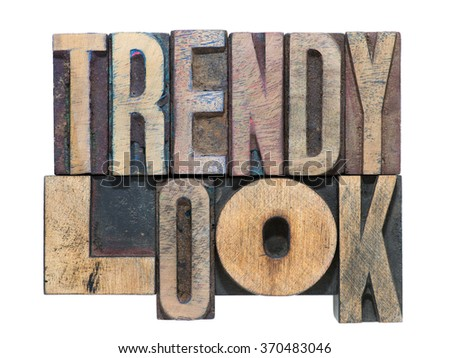 trendy look phrase made from mixed wooden letterpress type isolated on white