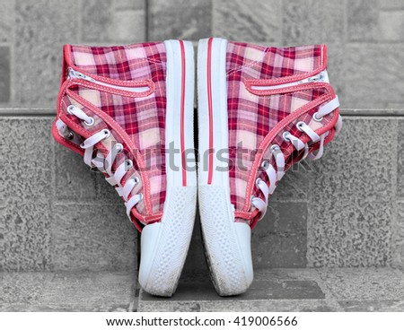 Trendy pink sneakers on the grey background - stock photo