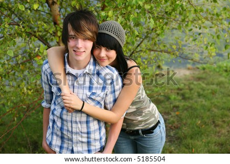 trendy teen caucasian couple outside