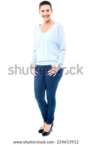 Trendy woman in casual wear posing with hands in her pocket - stock photo