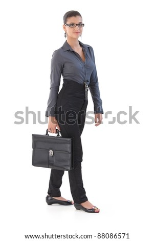 Trendy young businesswoman with briefcase, walking.?