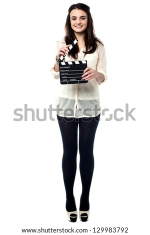 Trendy young girl posing with a clapperboard isolated on white. - stock photo