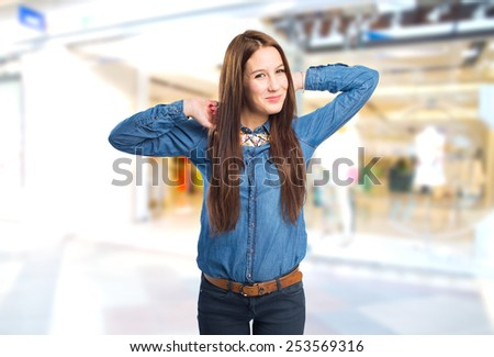 Trendy young woman looking tired. Over shopping centre background