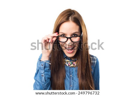 Trendy young woman looking with glasses looking surprised. Over white background - stock photo