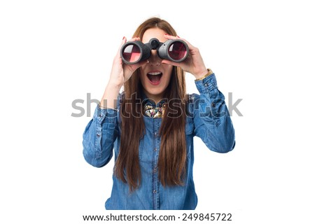 Trendy young woman using binoculars. She looks surprised. Over white background - stock photo