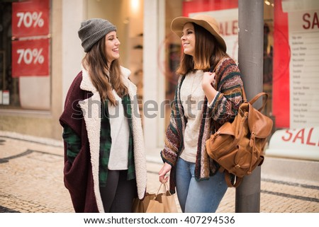 Trendy young women shopping in the city