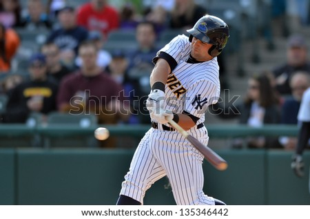 TRENTON, NJ - APRIL 13: Trenton Thunder batter Kyle Roller prepares to connect with a pitch for a homer during an Eastern League game against Richmond April 13, 2013 in Trenton, NJ. - stock photo