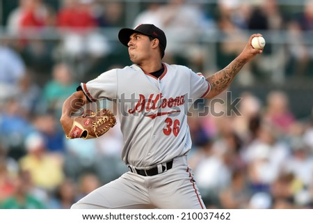TRENTON, NJ - August 7: Altoona Curve pitcher Jhonathan Ramos (36) throws a pitch during the Eastern League minor league baseball game played August 7, 2014 in Trenton, NJ.  - stock photo