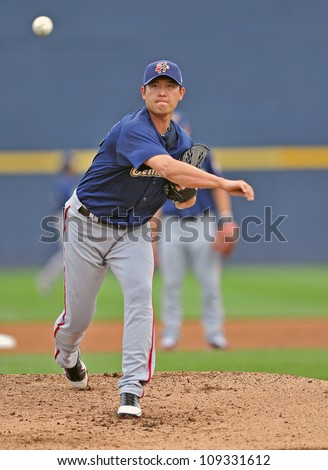 TRENTON, NJ - JULY 28: Harrisburg pitcher Chien-Ming Wang, on an injury rehab assignment, warms up on the mound prior to a baseball game July 28, 2012 in Trenton, NJ.