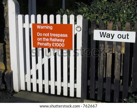 Trespass sign on railway gate