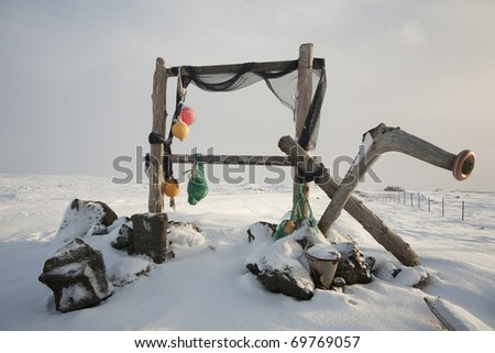 Trestles for hanging up fish to dry - stock photo