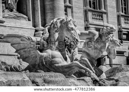 Trevi Fountain (architect Nicola Salvi, 1762). Trevi Fountain is most famous and arguably most beautiful fountain in Rome. Impressive monument dominates small Trevi Square. Italy. Black and white.