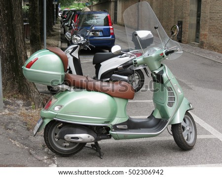 TREVISO, ITALY - CIRCA JULY 2014: Light green Piaggio Vespa vintage motorbike parked in a street of the city centre.