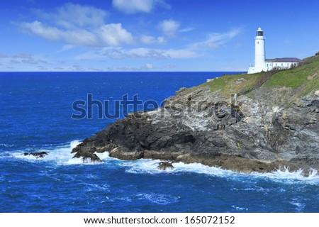 Trevose Head Lighthouse overlooking blue ocean, Cornwall. - stock photo