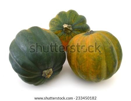 trhee ripe harvested acorn squash isolated on white  - stock photo