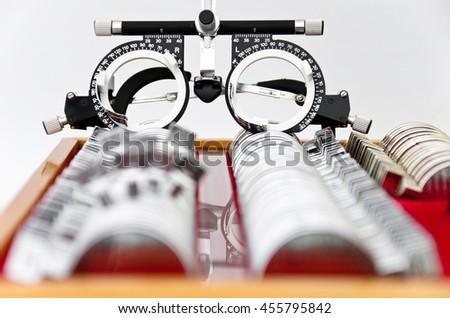 trial lens kit and frame for eye exam on white - stock photo