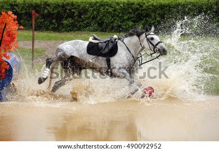 Trial rider fall in water jumping