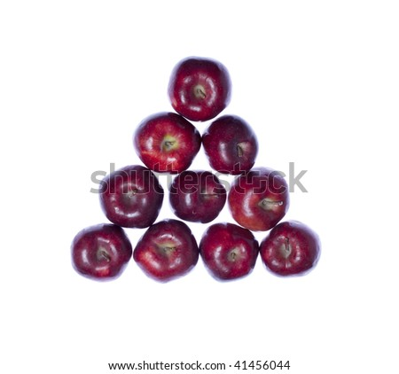 Triangle from fresh red apples on white isolated