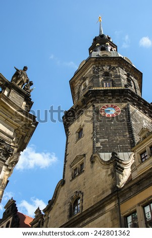 Triangulationss���¤ule Schlossturm Dresden, Germany, from street level with red and blue tower clock - stock photo