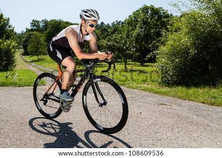 triathlete on a bicycle - stock photo