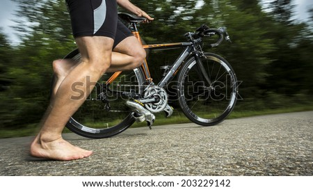 triathlete with a bicycle - stock photo