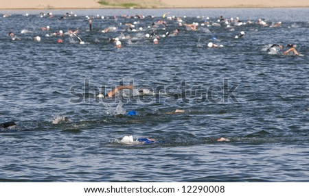 Triathlon - Lake swim, first event - stock photo