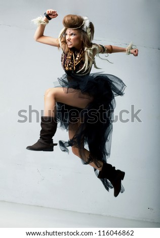 Tribe. Wild tribal person jumping - retro fashion ancient style. Antique - stock photo