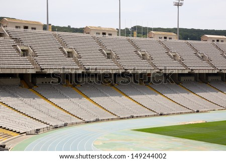 Tribunes of abandoned olympic stadium in Barcelona, Spain - stock photo