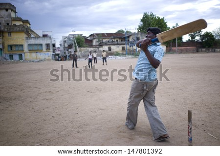 TRICHY, INDIA - 16 AUG: A group of high school students have a cricket game on the school playground on July 16, 2008. Cricket is a national game of India, where everyone loves this sport. - stock photo