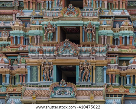 Trichy, India - October 15, 2013: Detail of the massive Rajagopuram of Ranganathar Temple. Focus on a couple of the openings protected by Dwarapalakas. Lakshmi on lotus showered by elephants. - stock photo