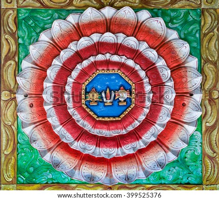 Trichy, India - October 15, 2013: Rosas, Mandala, lotus shaped painting on the ceiling of Anna Mandapam. The colors of the Indian flag with the symbols of Lord Vishnu in the center. - stock photo