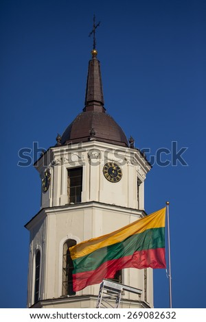 Tricolor flag of Lithuania in front of the Belfry of Vilnius Cathedral in Vilnius, Lithuania - stock photo